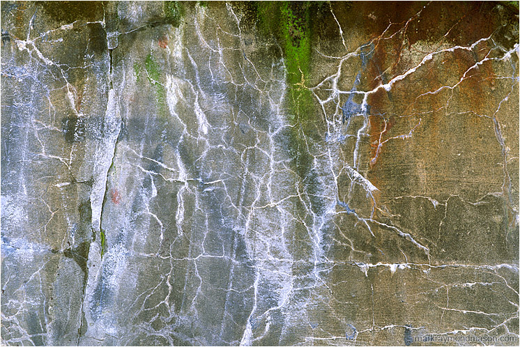 Cracked Concrete: Vancouver, BC, Canada (2005-00-00) - Abstract photograph showing graffiti and patterned cracks in concrete wall