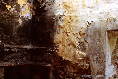 Abstract photo of singed plaster and wood in an abandoned house