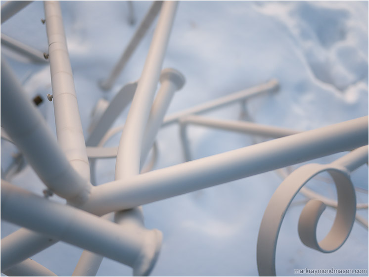 Scrap Metal, Snow: Calgary, AB, Canada (2010) - Abstract photograph of twisted white metal shapes against a frozen snowy field