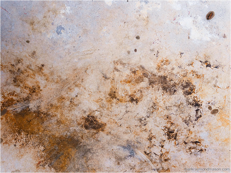 Stained Tabletop: Near Kamloops, BC, Canada (2012) - Abstract photograph showing stormy-looking stains on the surface of a plastic picnic table