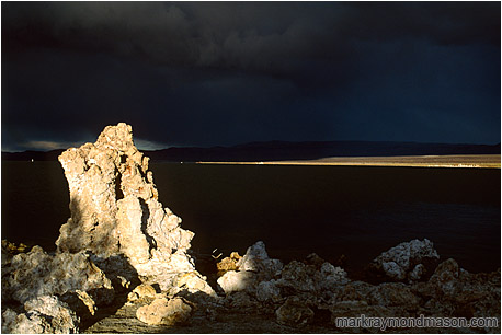 Fine art photograph of a salt tuffa and an approaching storm cloud