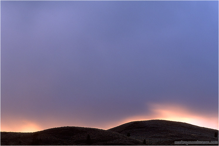 Sweeping Light, Clouds: Near Penticton, BC, Canada (2002) - Fine art photograph of storm clouds over the hills at sunset