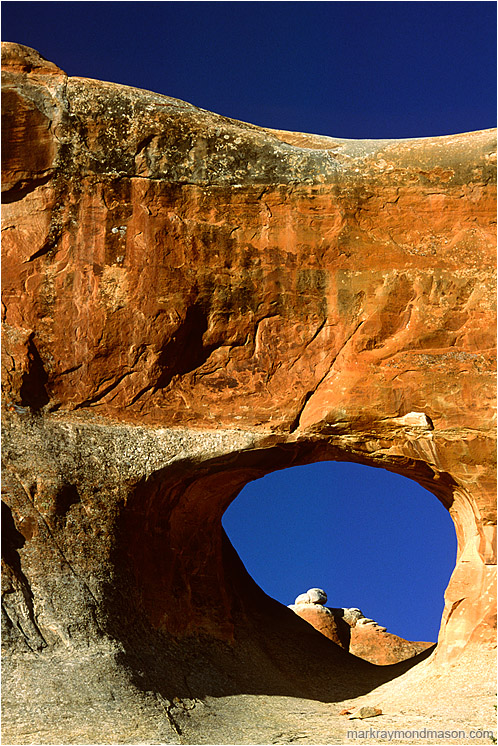 Arch, Sandstone Mountain: Arches, UT, USA (2003-00-00) - Abstract photograph of sculpted sandstone mountains, arches and shadows