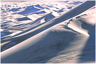 Big Dunes, Snow: Death Valley, CA, USA (2003) - Abstract photograph of huge sand dunes, snow, and shadows deep in the desert