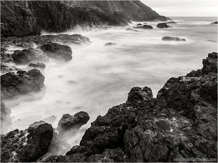 Steep Bay, Smokey Sea: Near Stawberry Hill Park, OR, USA (2015) - Fine art black and white long exposure photograph of waves crashing on a rugged bay