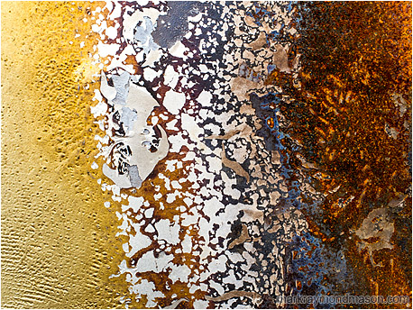 Abstract photo of progression and evolution in chipped paint patterns, from plain fibre to complex lava-like rust