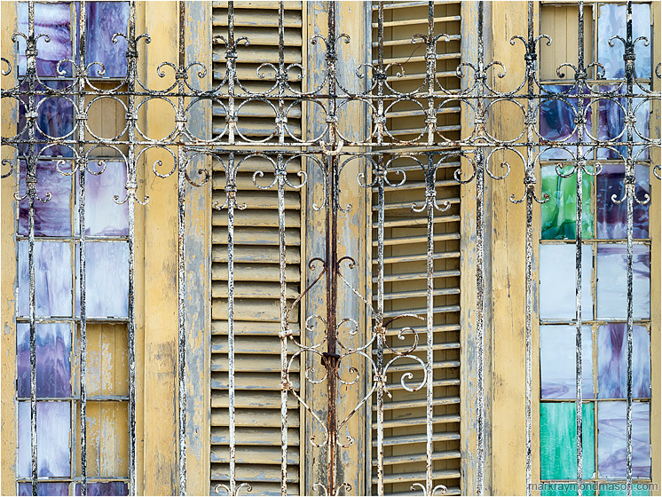 Glass, Slats, Bars: Regla, Cuba (2017-02-15) - Abstract photography showing small stained glass windows and wooden shutters behind ancient wrought-iron bars