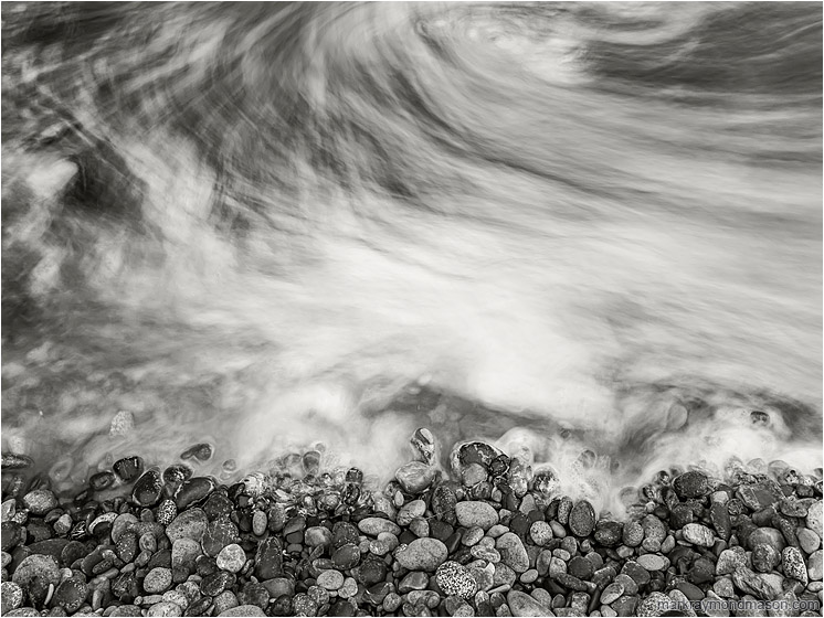 Rocks, Clouded Sea: Olympic National Park, WA, USA (2017-08-16) - Fine art black and white long-exposure photograph showing moving water swirling like fog around seaside stones